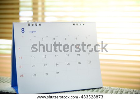Blurred calendar page blur background.August - stock photo