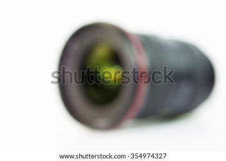 Blurred camera lens on white as background - stock photo