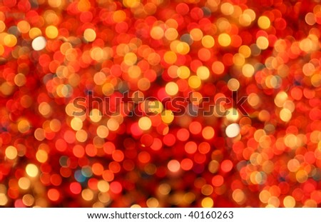 Blurred candle light background with reds, yellows and blues - stock photo