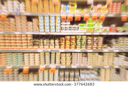 Blurred canned food products at a supermarket - stock photo