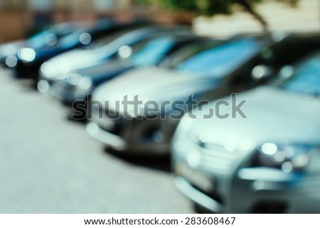 Blurred cars parked on the street - stock photo