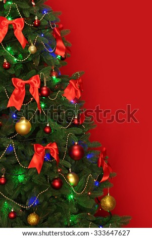 Blurred Christmas tree on red background - stock photo