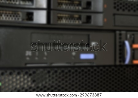 Blurred Computer Server and tape drive in datacenter - stock photo