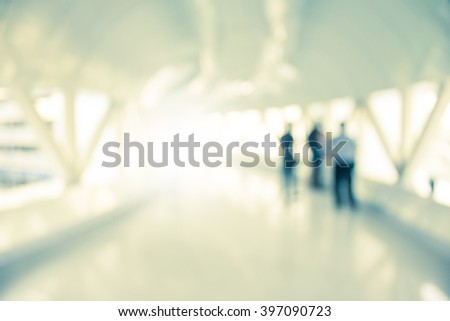 Blurred Corridor in office with blur three man ,Vintage tone - stock photo