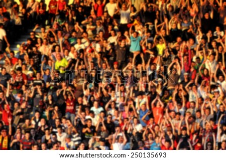 Blurred crowd of people in a stadium - stock photo