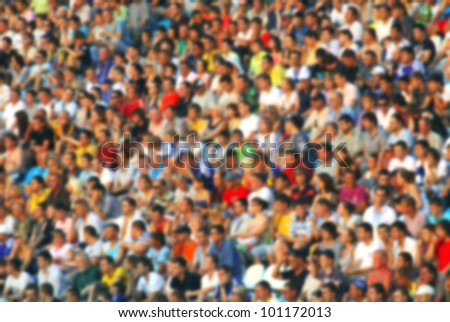 Blurred crowd of spectators at the stadium - stock photo