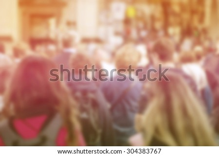 Blurred Crowd of Young People On Street, General Public Concept with Unrecognizable Crowded Population out of Focus, Vintage Toned Image. - stock photo