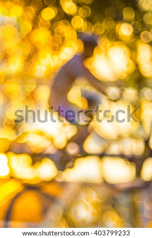 Blurred cyclist in the park when the sunsets - stock photo