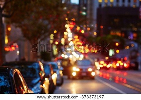 Blurred defocused car lights, heavy traffic in San Francisco, California, USA - stock photo