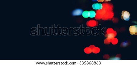 Blurred Defocused Color Lights in City Streets. Dark Abstract Background for web design - stock photo