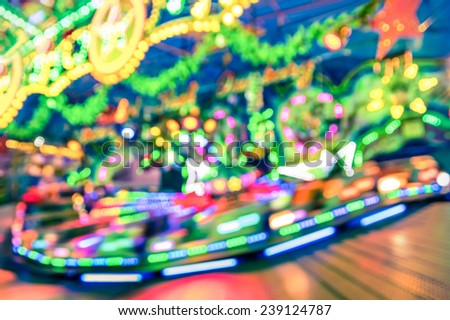 Blurred defocused lights at luna park carousel roundabout - German christmas market at Alexander Platz in Berlin - Fantasy imagery background of childhood fun games and dreams - stock photo