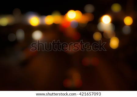 Blurred Defocused Lights of Heavy Traffic on a  City Road at Night - Commuting at Rush Hour  - stock photo