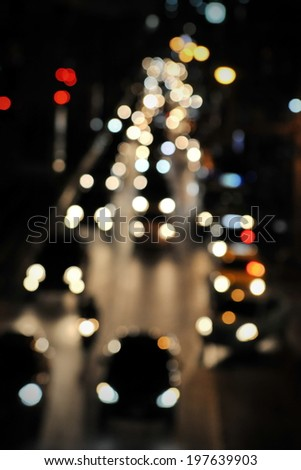 Blurred Defocused Lights of Traffic on a City Road at Night - stock photo