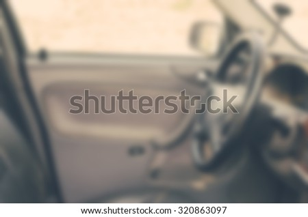 Blurred defocused photo of the car interior with vintage filter and soft light - stock photo