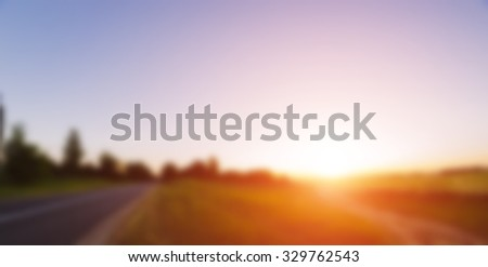 Blurred defocused photo of the summer sunset landscape - stock photo