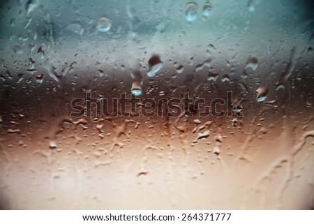 Blurred drops background.Rainy window. - stock photo