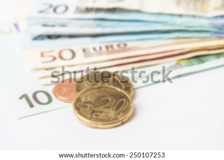 blurred Euro (EUR) banknotes and coins money useful as a background or money concept  - stock photo
