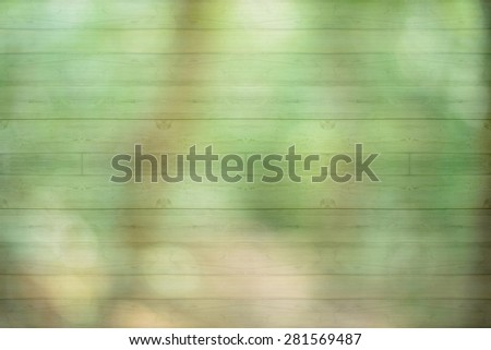 Blurred forest on wooden texture,abstract background to happiness of nature. - stock photo