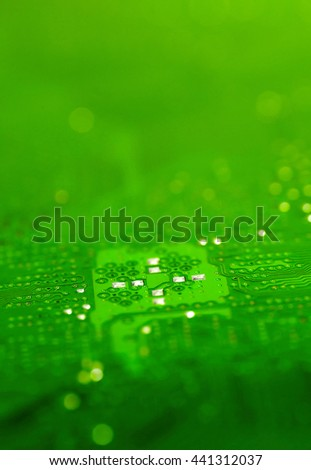 blurred green pcb motherboard chip microchip integrated circuit board pattern background - stock photo
