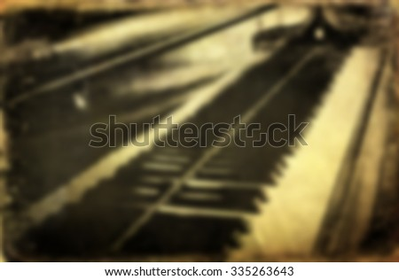 Blurred Grunge piano musical background and added paper texture  - stock photo