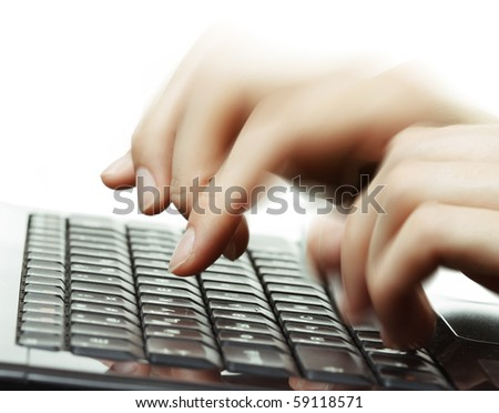 Blurred hands typing on computer keyboard - stock photo