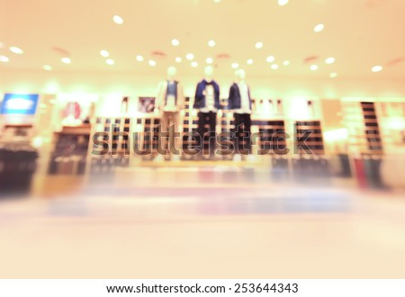 blurred image background with clothing store in a shopping mall. - stock photo