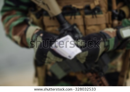 blurred image of Army ranger during the military operation - stock photo