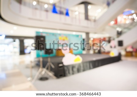 Blurred image of auditorium and stage in hall , blur background with bokeh . - stock photo