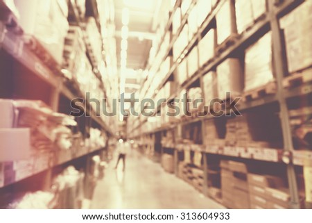 blurred image of boxes in factory warehouse with light leak filter. - stock photo
