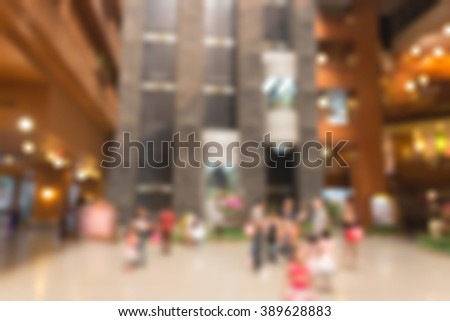 blurred image of hotel lobby with glass elevator - stock photo