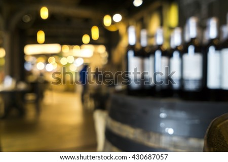 Blurred image of liquor shop for background uses. - stock photo
