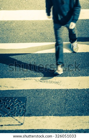 Blurred image of pedestrian people moving at zebra crosswalk. Hong Kong. Crowded city abstract background in vintage style - stock photo