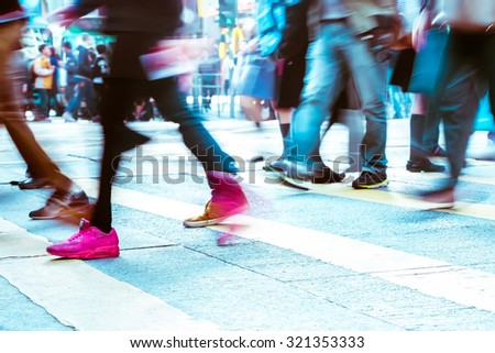 Blurred image of people moving in crowded city street. Art toning abstract urban background. Hong Kong - stock photo