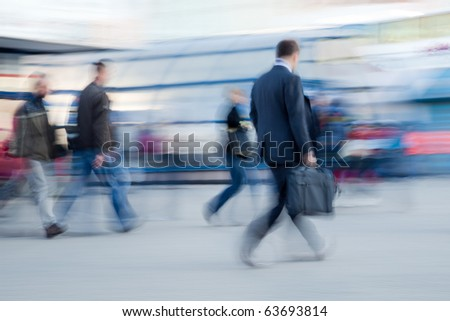 Blurred image of people rushing to office in the morning - stock photo