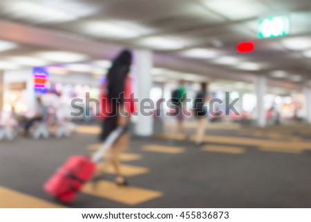 blurred image of people walk in the airport terminal - stock photo