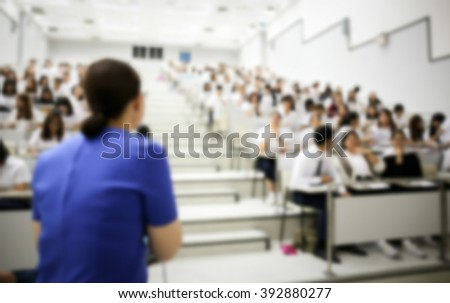 blurred image of teacher speak with student at conference hall in classroom education - stock photo