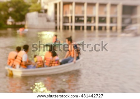 Blurred image of tourist kayaking in the pond or lake with retro effect - stock photo