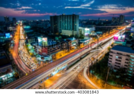 Blurred image of traffic city night at bangkok, thailand - stock photo