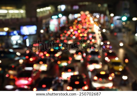 blurred image of traffic jam at night in thailand - stock photo
