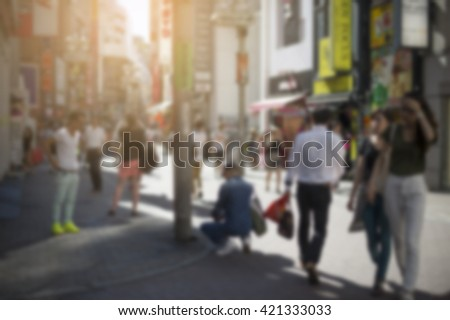 Blurred image of urban life at shinjuku tokyo japan and cross process and soft flare filter - stock photo