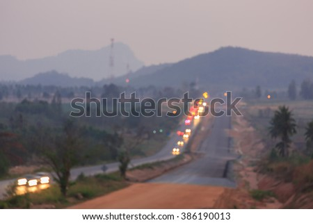 Blurred image traffic road and hill - stock photo