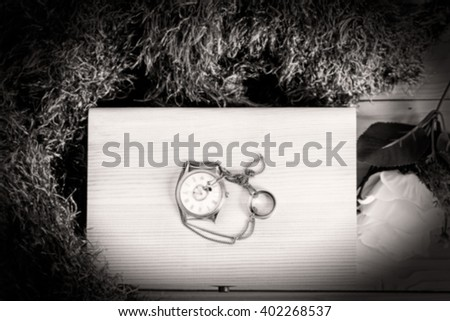 blurred image : Vintage still life with watch on a wooden box - blur style for background - stock photo