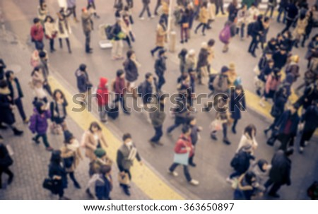 Blurred image with people walking in Shibuya, Tokyo. Concept about urban life, tourism and business - stock photo