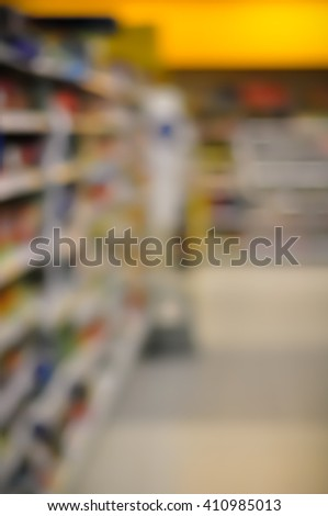 Blurred Interior Image. Inside of  Grocery Store with brightly color merchandise. - stock photo