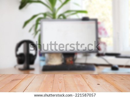 Blurred interior of place of work with wooden surface - stock photo