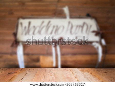 Blurred interior of wedding party sign with wooden surface - stock photo