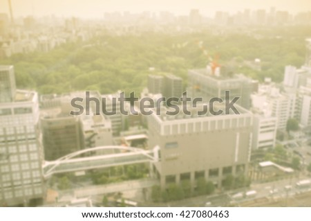 Blurred landcape tokyo city from shinjuku japan and cross process and soft flare filter - stock photo