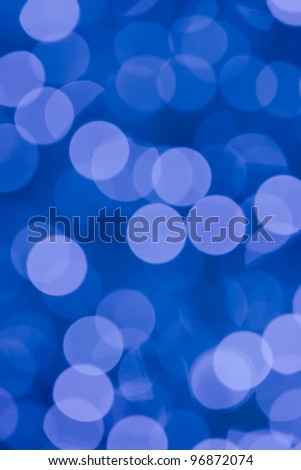 Blurred lights against a blue background - stock photo