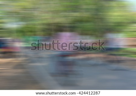 Blurred motion of people biking bicycle on the road - stock photo