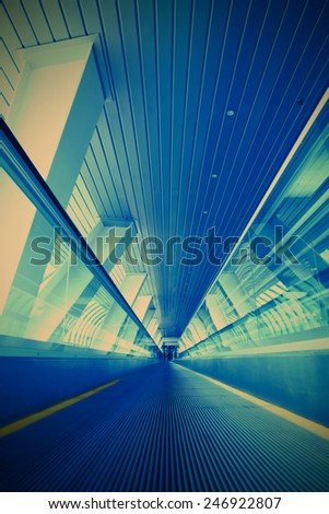 blurred moving escalator in the businnes center, instagram image style - stock photo